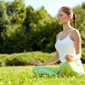 Young and beautiful woman doing yoga exercises .Yoga background